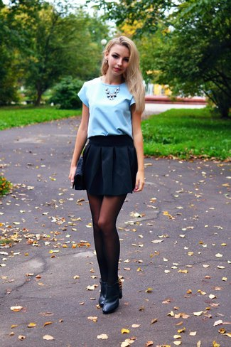 Light sky blue blouse with black minirater skirt