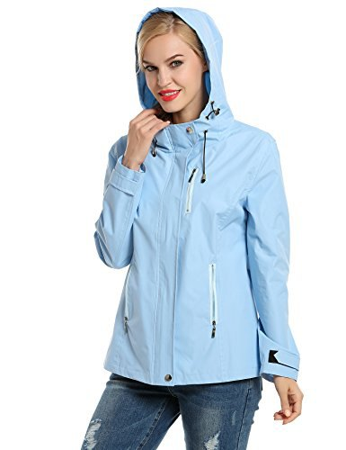 Light sky blue nylon sports jacket with hood and ripped jeans