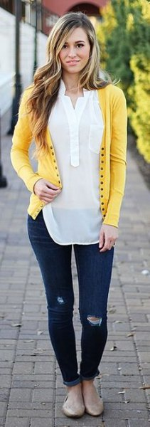 light yellow cardigan with white, semi-transparent polo shirt