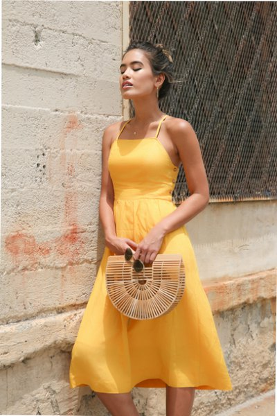 light yellow fit and a flared halter neck chiffon dress