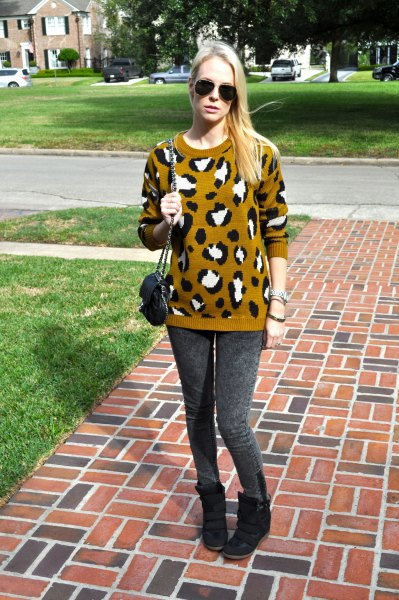 Lime green and black printed knitted sweater with gray leggings and wedge shoes