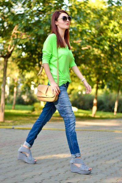 Lime green buttonless shirt with slim fit jeans with blue cuffs