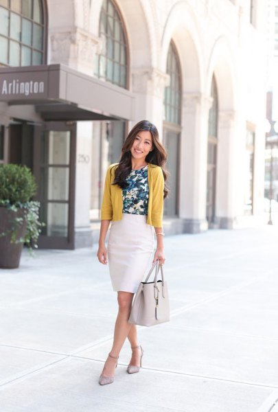 Lime green short cut cardigan with a white pencil skirt