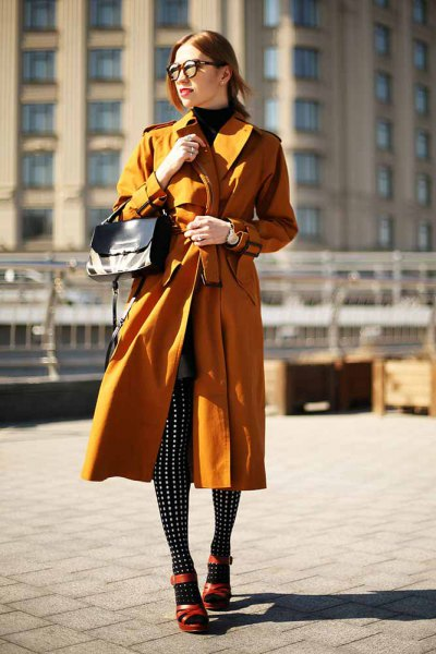 Lime green longline trench coat with black and white polka dot gaiters