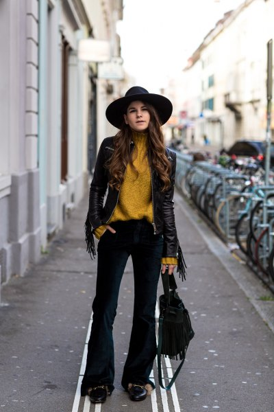 Lime green turtleneck with a black leather jacket and flared velvet jeans