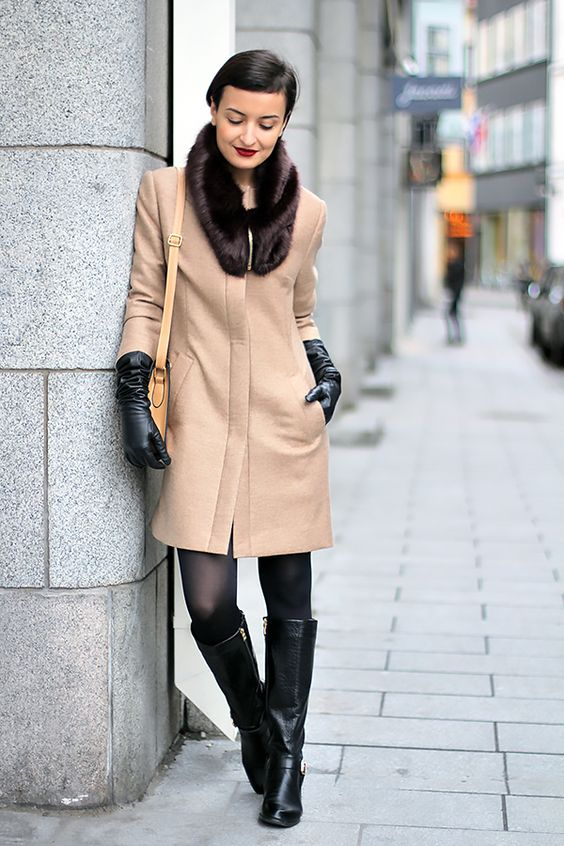 long camel coat with black gloves