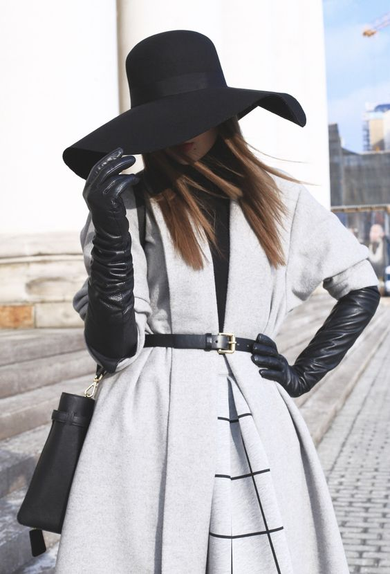 long gray coat with black gloves