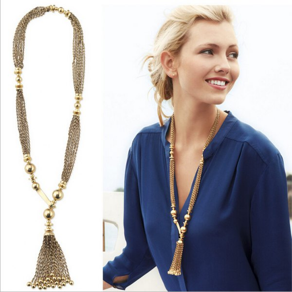 long gold chain in boho style with dark blue chiffon blouse