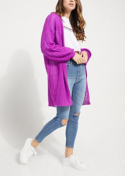 long, chunky, purple cardigan with ripped skinny jeans