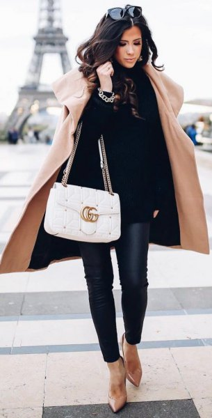 long coat with black turtleneck and leather pants