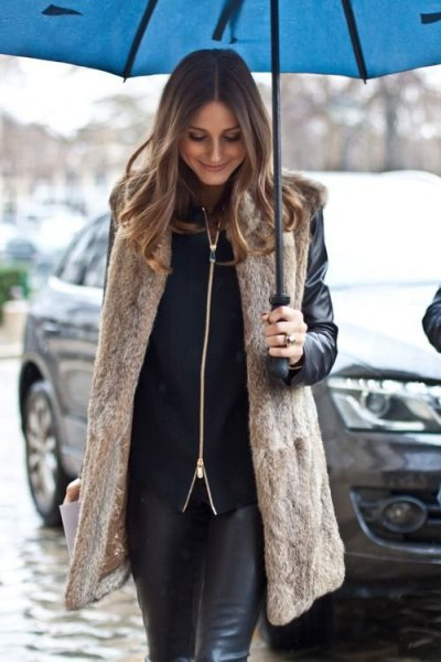 long light brown vest with black biker jacket and leather gaiters
