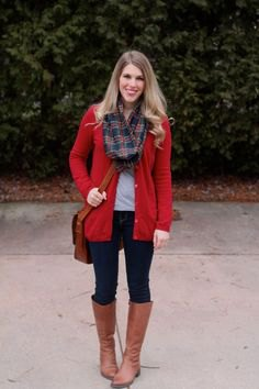long red cardigan with a gray and dark blue checked scarf and knee-high brown boots