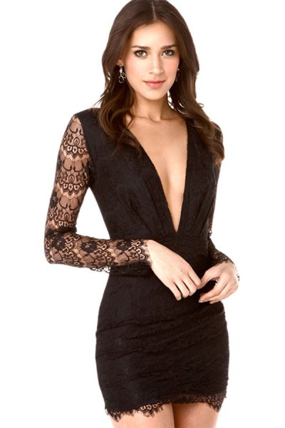 long-sleeved black, figure-hugging mini dress with lace sleeves