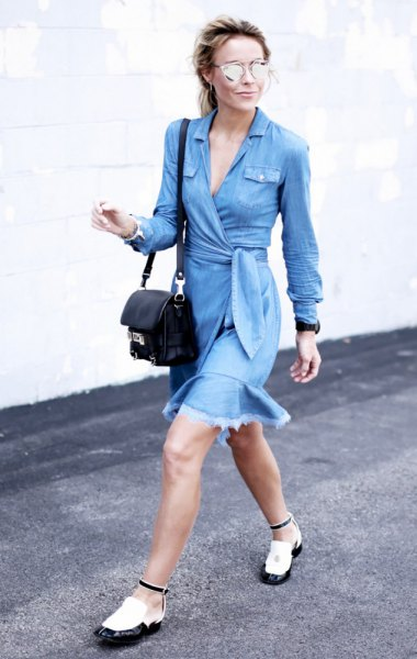 long-sleeved blue dress with waistband and white and black leather