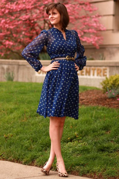 Long-sleeved, knee-length, blue polka dot dress with a chiffon belt and belt