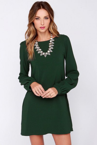 Long-sleeved mini dress with a silver statement chain