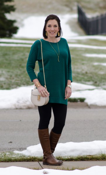 long-sleeved striped sweater with black leggings and brown leather boots