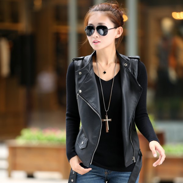 long statement chain with black long-sleeved T-shirt and leather vest