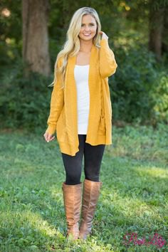 Longline cardigan with a white tunic top and brown knee-high leather boots