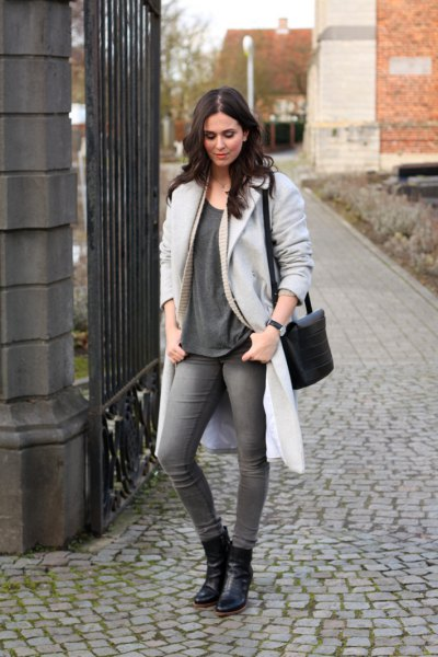 light gray longline coat with oversized t-shirt and leather ankle boots