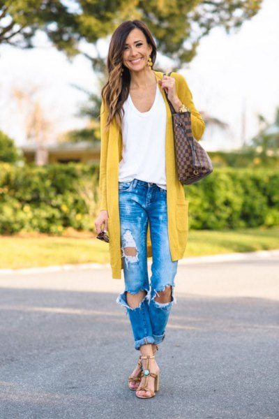 Longline mustard yellow cardigan with blue ripped jeans