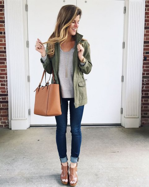 Olive-colored long-linen jacket with a gray tunic top and jeans with cuffs