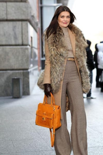 Longline vest with a gray mock-neck sweater and wide-leg pants