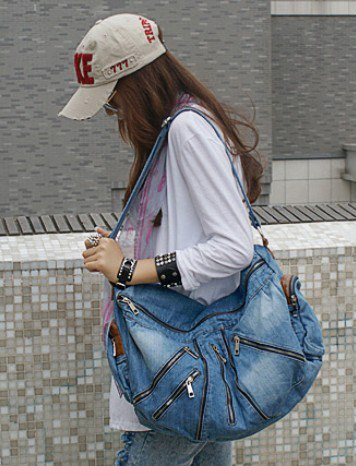 beautiful blue denim travel bag with tunic shirt and washed, narrow-cut jeans