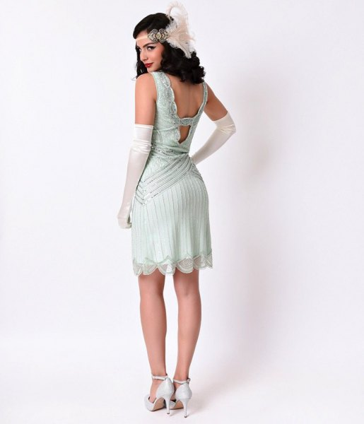 Flapper dress with a low back and white heels