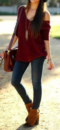 Maroon one shoulder sweater with a relaxed fit and a long, boho style necklace