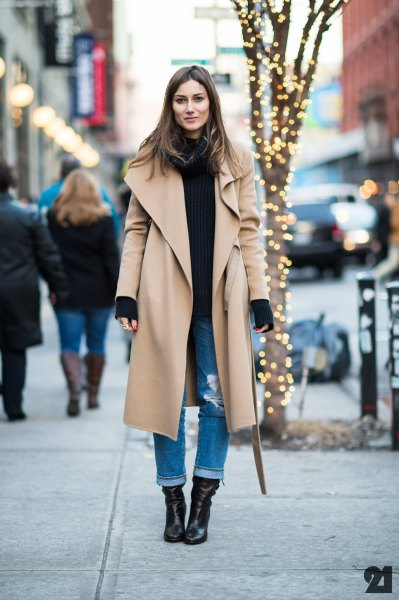 Maxi camel longline jacket with black sweater and jeans with cuffs