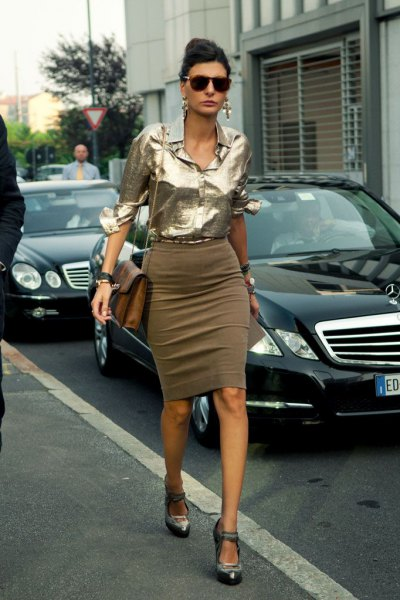 Metallic blouse with a green, figure-hugging midi skirt