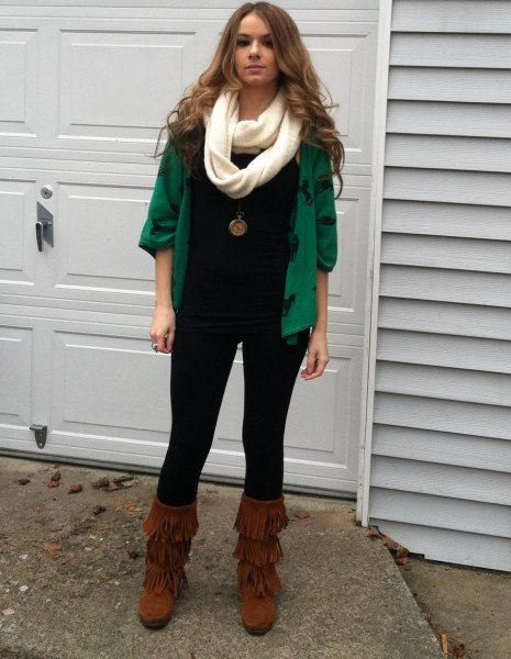 green cardigan with fringed boots in the middle of the calf