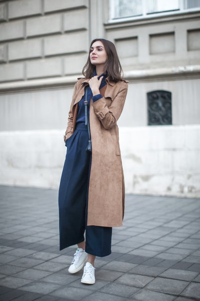 Midi-long gray-brown suede coat with dark blue trousers with wide legs