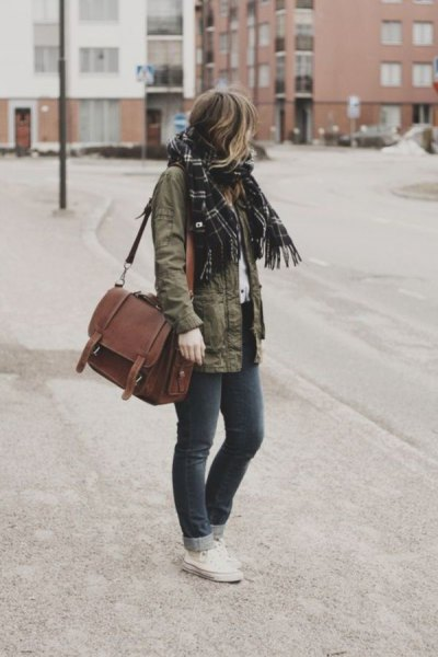 Military jacket with black plaid scarf and shoulder bag made of brown suede