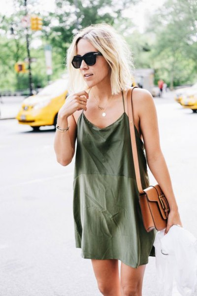 Mini green silk sheath dress with brown leather shoulder bag