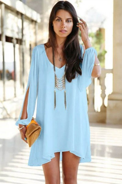 Mini light blue long sleeve dress with a boho statement necklace