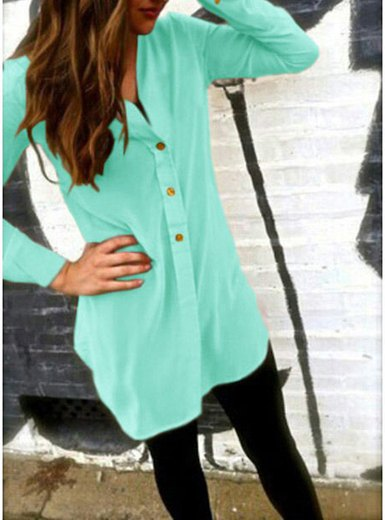 Mint green, collarless tunic shirt with buttons and black leggings