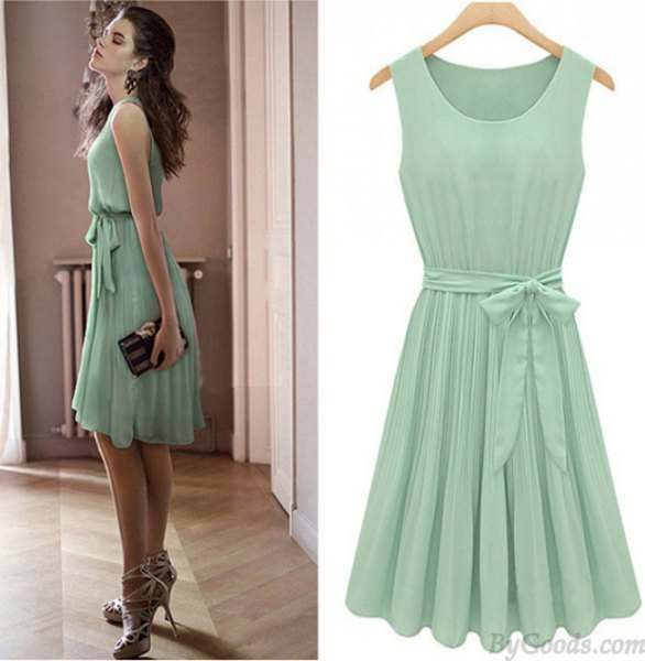 Mint green tie, knee-length, pleated skater dress with strappy heels