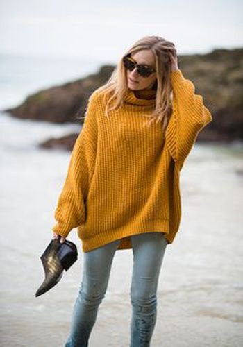 Chunky ribbed sweater with mock neck and light gray slim fit jeans