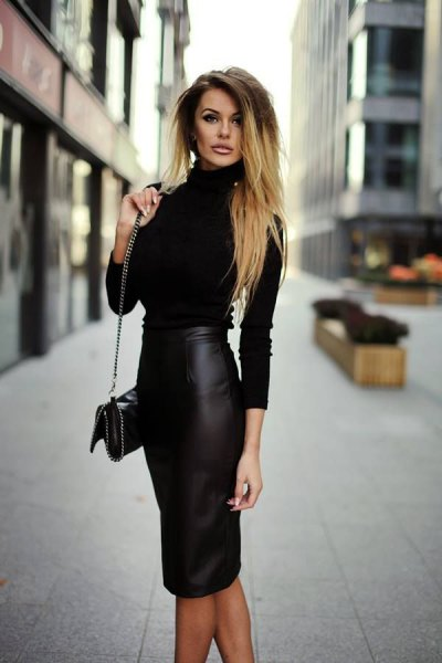figure-hugging sweater with mock neckline and figure-hugging midi faux leather skirt