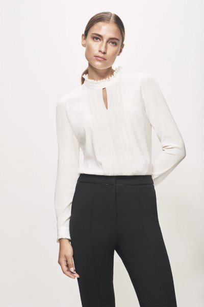 Silk blouse with mock-neck keyhole and black high-rise chinos