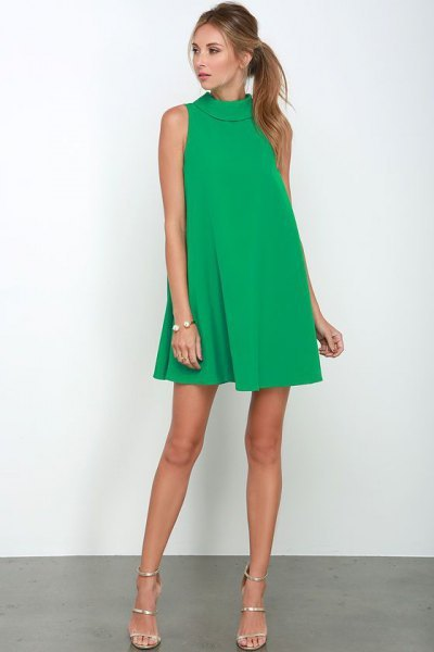Mock neck mini green cocktail dress with silver open toe heels