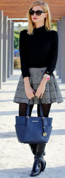 Mock neck sweater with black and white checked pleated miniature skirt