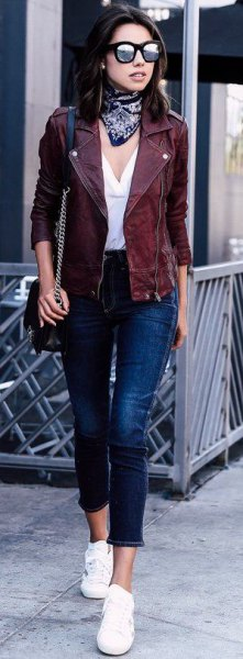 Moto jacket with white blouse with V-neck and short jeans