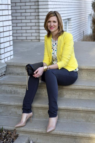 multicolored polka dot blouse and blue jeans
