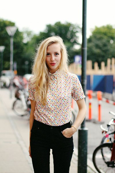 multicolored shirt with dotted buttons and black jeans