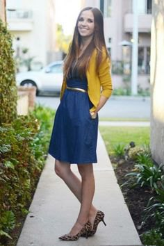 Mustard cropped cardigan with knee-length denim dress with belt