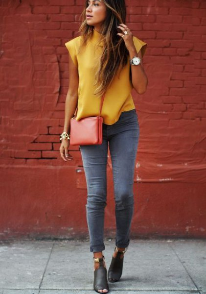 Sleeveless blouse with mustard mock neck and gray skinny jeans with cuffs