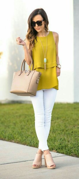 sleeveless mustard top with white skinny jeans and blushing open toe boots